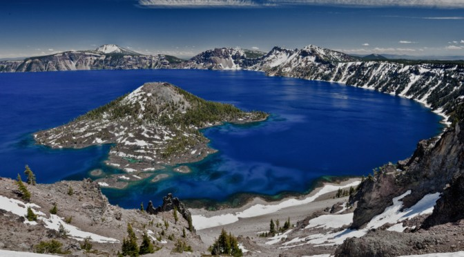 Crater Lake and Wizard Island, looking east toward Mount Scott on far side, Crater Lake National Park, Oregon, USA. Crater Lake was created by the cataclysmic eruption of Mount Mazama about 7700 years ago.